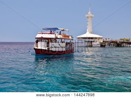 Pleasure tourist boat at coral reef near Eilat -  famous resort city in Israel