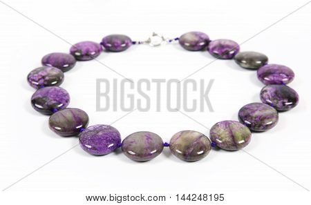 Necklace from a natural violet stone from charoite