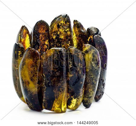 Bracelet of Baltic amber isolated on white background, resin, yellow,