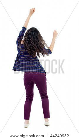 back view of dancing young beautiful  woman. girl  watching. Rear view people collection.  backside view of person.  Isolated over white background. Long-haired curly girl in a blue jacket moves his