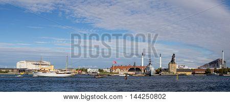 Copenhagen, Denmark - August 17, 2016: Panoramic view of Copenhagen harbor with the Royal Danish yacht and the Danish naval base