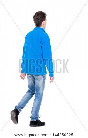 Back view of going  handsome man. walking young guy . Rear view people collection.  backside view of person.  Isolated over white background. Curly boy in blue jacket standing on one leg.