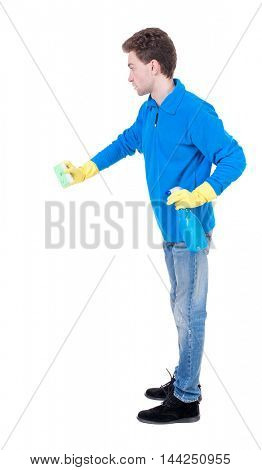 side view of a cleaner man in gloves with sponge and detergent. girl  watching.  view of person.  Isolated over white background. Curly boy in a warm blue sweater sponge.
