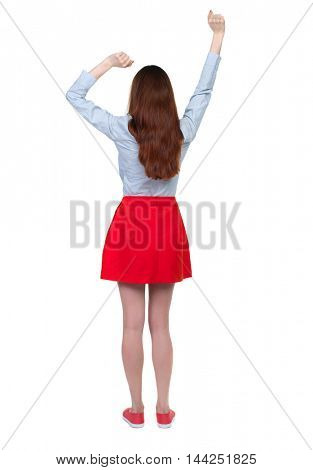back view of dancing young beautiful  woman. girl  watching. Rear view people collection.  backside view of person.  Isolated over white background.Long-haired brunette in red skirt lifted up his