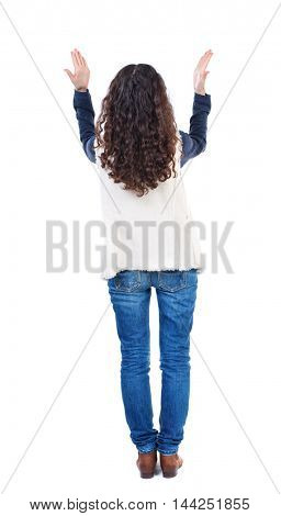 Back view of angry young woman Rear view. isolated over white. backside view of person.  Rear view people collection. Isolated over white background. Long-haired girl with curly hair, emotional