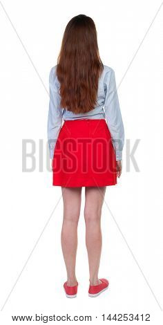 back view of standing young beautiful  woman.  girl  watching. Rear view people collection.  backside view of person. Long-haired brunette is back in the red skirt.