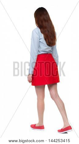 back view of walking  woman. beautiful blonde girl in motion.  backside view of person.  Rear view people collection. Isolated over white background. Long-haired brunette in red skirt moves slowly.