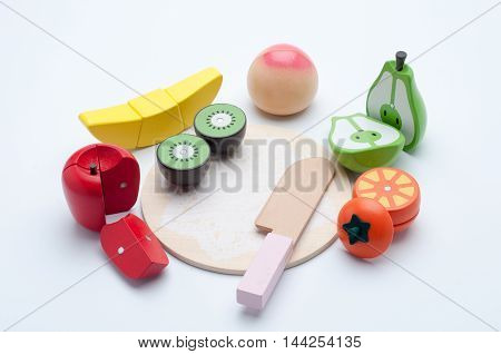 Fruits wooden toy isolated on white background.