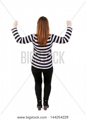 Back view of woman. Raised his fist up in victory sign. Raised his fist up in victory sign. Girl in a striped sweater raised his hands with joy.