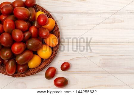 Pile of ripe tomatoes (Cherry, Black Prince)