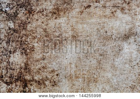 Old rusty metal surface is covered with several layers of peeling paint of different colors. background