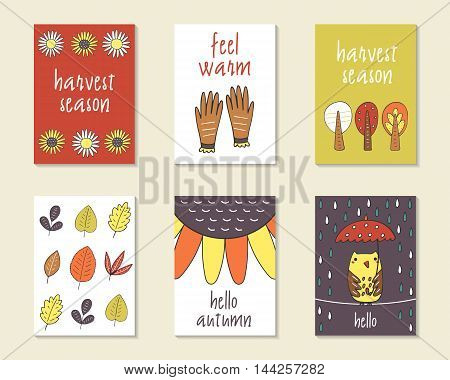 Cute doodle autumn cards brochures invitations with sunflower gloves trees leaves owl rain umbrella Cartoon objects animals background Printable templates set
