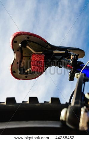Bicycle Seat and Tire Against A Blue Sky
