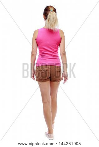 back view of walking woman. Isolated over white background. Sport blond in brown shorts goes back frame.