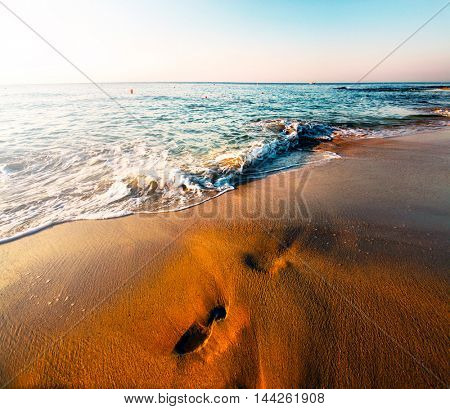 Perspective view of summer beautiful exotic beach over blue sky in sunny Greece