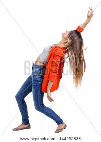 Balancing young woman. or dodge falling woman. girl in a red jacket leaning back.
