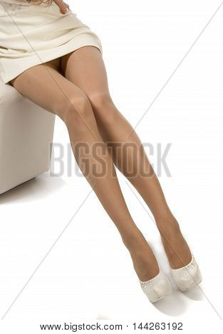 Beautiful legs in pantyhose.. Feet girl photographed in the studio.