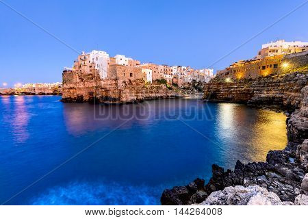 Puglia Italy. Sunset scenery of Polignano a Mare town in the province of Bari Apulia southern Italia on the Adriatic Sea