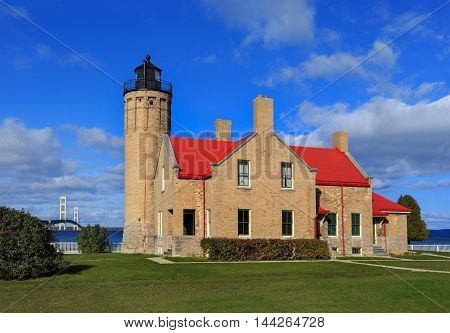 The Old Mackinac Point Lighthouse poised on the Lower Peninsula end of the Mackinac Bridge at the Straits Of Mackinac Michigan USA