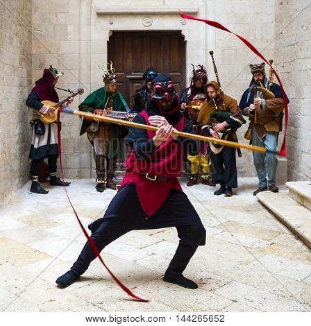 Altamura Italy - April 25 2016: musical group in medieval costume accompanies the exhibition of a dancer. Fifth edition of