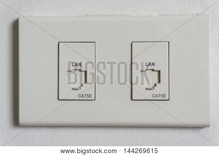 LAN Cable plug wall outlet for computer network.