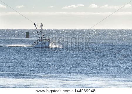 Sandwich Massachusetts USA - September 14 2014: Fishing boat returning from trip on windy Cape Cod Bay