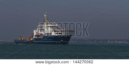 photo of a ship with buoys on the main deck