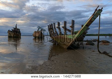 some dilapidated fishing boats were left stranded at the mouth of river sand spread Sitompok Kuala Penyu Sabah.