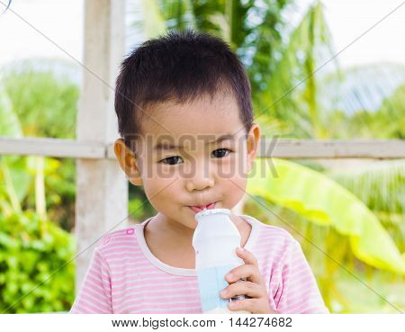 Drinking milk Asian children in a park.