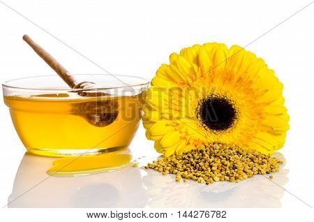 The Bowl Of Honey With Flower  And Heap Of Pollen Isolated On White