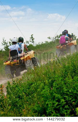 quad bike on a country road clear summer day