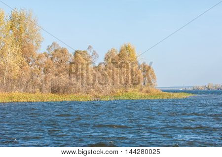 Fall River. Autumn Colorful Foliage Over Lake With Beautiful Woods In Red And Yellow Color.