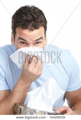 Young man having flu or allergy. Isolated over white background