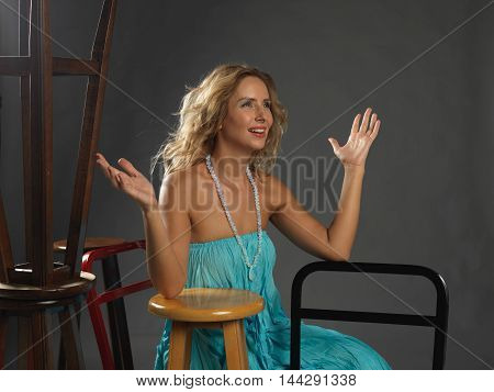 beautiful young fashion women wearing green dress and posing in studio