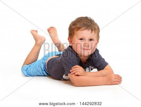 Little boy relaxing. Healthy and happy people isolated on white background.