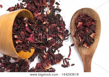 Dried hibiscus flower into a spoon in white background