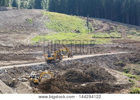 Excavation work during the construction of the road in the mountains. View from above.