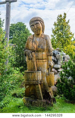 HORBOW, POLAND - AUGUST 17, 2014: Wooden figure near the Pajero Hotel in Horbow, Poland. Pajero hotel is located on the International road E-30, 20 km from the Belorussian Frontier