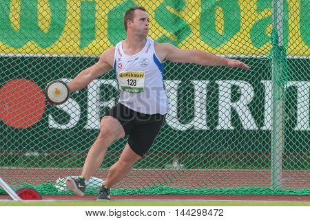 KAPFENBERG, AUSTRIA - AUGUST 8, 2015: Lukas  Weishaidinger (#128 Austria) participates in the national track and field championship.