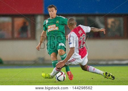 VIENNA, AUSTRIA - JULY 29, 2015: Stefan Schwab (SK Rapid) and Kenny Tete (Ajax) fight for the ball in an UEFA Champions League qualification game.