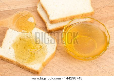 Delicious honey white bread wooden spoon on the table