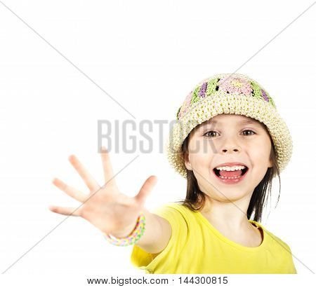 A cute little girl happily shows an open hand on a white background