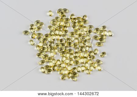 Vitamin E Pills Capsules White Background Isolated overhead view top wide crop