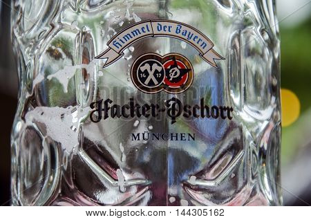 Munich Bavaria / Germany- August 8 2016: The logo on the empty beer mug (maßkrug) in the Brewery Hacker-Pschorr.