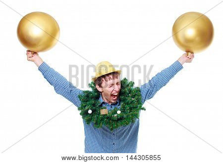 guy having fun at Christmas party isolated on white background. young man with a Christmas wreath around his neck, golden hat, large golden Christmas balls in hands dancing and screaming. the concept of a fun party on Christmas or the New year