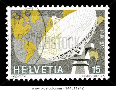 SWITZERLAND - CIRCA 1973 : Cancelled postage stamp printed by Switzerland, that shows Parabolic antenna and world map.