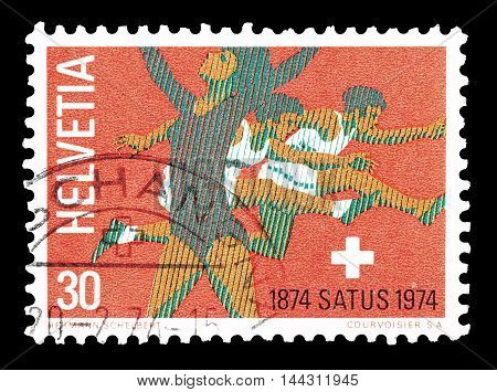 SWITZERLAND - CIRCA 1974 : Cancelled postage stamp printed by Switzerland, that shows Rhythmic gymnast and hurdlers.