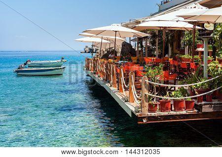LOUTRO, CRETE, GREECE - JULY 2016: Traditional Greek taverna near sea at Loutro town on Crete island.