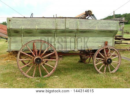 An old wooden wheel  wagon probably used for hauling grain.