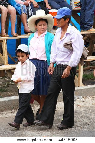 Cajamarca Peru - February 8 2016: Peruvian family from Sierra Mountains walks together in Cajamarca Peru on February 8 2016